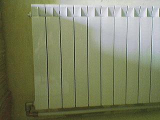 Bimetal radiator - pipe out (\